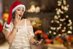 Christmas girl showing empty palm with copy space smile surprisi Royalty Free Stock Image