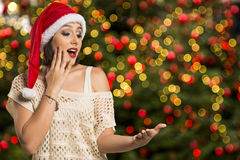 Christmas girl showing empty palm with copy space smile surprisi Stock Image