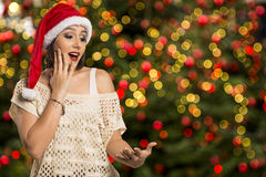 Christmas girl showing empty palm with copy space smile surprisi Royalty Free Stock Images