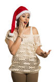 Christmas girl showing empty palm with copy space smile surprisi Royalty Free Stock Photos