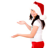 Christmas girl showing something Royalty Free Stock Photography
