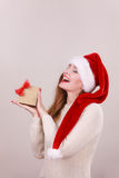 Christmas girl with small gift. Stock Image