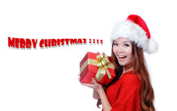 Christmas Girl Smile Holding Gift Box. Model is a cute Asian beauty,  isolated on white background Stock Image