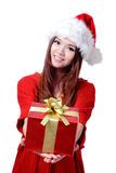 Christmas Girl Smile Holding Gift Box. Model is a cute Asian beauty,  isolated on white background Royalty Free Stock Image