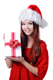 Christmas Girl Smile Holding Gift Box. Model is a cute Asian beauty,  isolated on white background Stock Photos