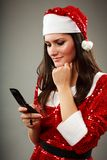 Christmas girl speaking with Santa Stock Photo