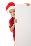 Christmas girl standing with empty blank Royalty Free Stock Photography