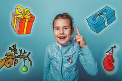 Christmas girl teen raised her thumbs up from Royalty Free Stock Photo