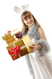 Christmas girl teenager holding gifts Stock Images