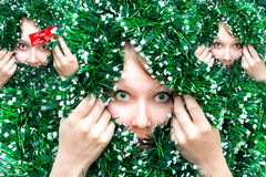 Christmas Girl in tinsel Stock Photos