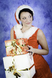 Christmas girl with two gifts Stock Photography
