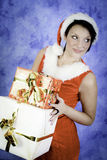 Christmas girl with two gifts Royalty Free Stock Images