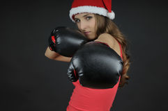 Christmas  girl wearing boxing gloves Stock Photos