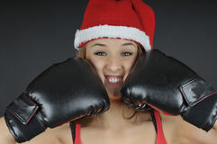 Christmas  girl wearing boxing gloves Stock Images