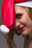 Christmas girl wearing santa hat Stock Photo