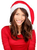 Christmas girl wearing santa hat. Portrait of Asian woman smiling happy on white background Royalty Free Stock Photography