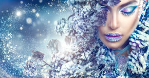 Christmas girl. Winter holiday makeup with gems on lips. Christmas beauty girl. Winter holiday makeup with gems on lips stock image