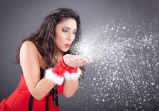 Christmas Girl.Winter woman Blowing Snow Royalty Free Stock Photo