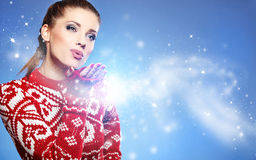 Christmas Girl. woman Blowing Snow Royalty Free Stock Photo