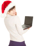 Christmas girl working on laptop Royalty Free Stock Image