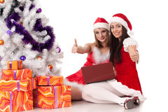 Christmas girlfriends with laptop. Royalty Free Stock Images