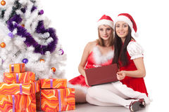 Christmas girlfriends with laptop. Stock Images