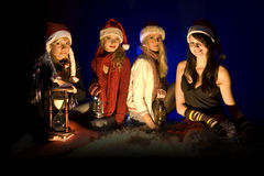 Christmas Girls. A portrait of four beautiful teenage girls wearing Christmas hats Stock Photo
