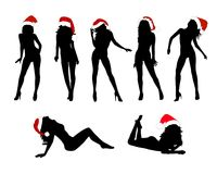 Christmas Girls. An illustrated set of silhouetted Christmas girls in various poses, isolated on white background Stock Photo