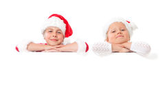 Christmas girls with blank placard Royalty Free Stock Image