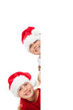 Christmas girls with blank placard Royalty Free Stock Photo