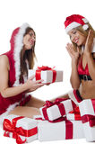 The Christmas girls with boxes of gifts isolated Royalty Free Stock Images