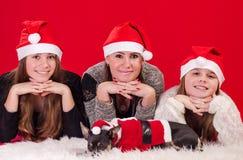 Christmas girls with cute dog Stock Image
