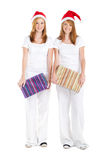 Christmas girls with gifts Royalty Free Stock Image