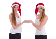 Christmas girls hold a gift on hands Stock Image