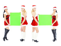 Christmas girls holding green blank banner Stock Photography