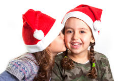 Christmas girls kissing Royalty Free Stock Photography