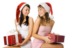 Christmas girls in red hat. Beauty christmas girls in red hat with box gift over white background Stock Images