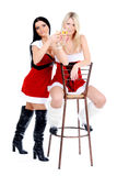 Christmas girls sitting on th stool Royalty Free Stock Photography