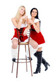 Christmas girls sitting on th stool Stock Photos