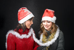 Christmas Girls Under Snowfall Royalty Free Stock Photo