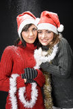 Christmas Girls Under Snowfall Stock Images