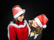 Christmas Girls Under Snowfall Stock Photography