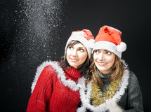 Christmas Girls Under Snowfall Stock Image