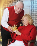 Christmas-Giving Senior stock image