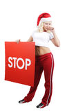 Christmas glamour. Beautiful woman  in a santa's cap cell phone. Isolated on white background Royalty Free Stock Images