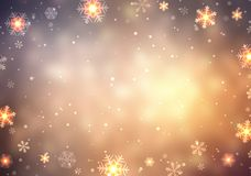 Christmas glare golden background decorated with snowflakes and lights. Empty festive blurred background. Bokeh snowflake texture. Royalty Free Stock Photo