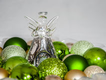 Christmas Glass Angel. Decorationand green balls stock photos
