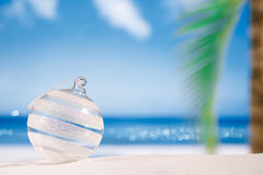 Christmas glass ball on  beach with seascape background Royalty Free Stock Photos