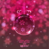 Christmas glass ball on blurred background with snowflakes, Stock Photo