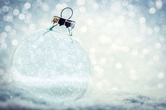 Christmas glass ball with empty interior. Snow and glitter royalty free stock photo